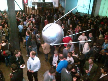 Sputnik satellite streaks through warehouse where Mirantis/Dell party is held.